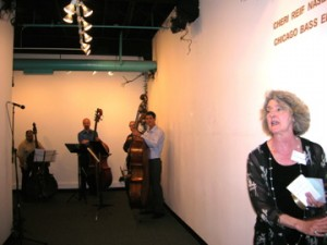 Cheri Reif Naselli in foreground, Chicago Bass Ensemble in the background